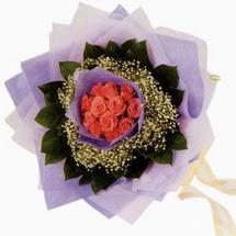 12 adet gül ve elyaflardan   Mardin çiçekçi mağazası